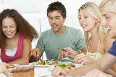 Friends Relaxing At Home Having Lunch Royalty Free Stock Photography
