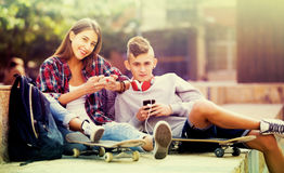 Friends relaxing with mobile phones Stock Image