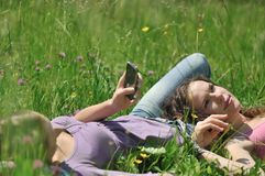 Friends relaxing outdoors in nature Royalty Free Stock Photo