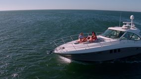 Friends relaxing on private yacht deck stock footage