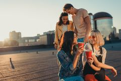 Friends relaxing on roof party Royalty Free Stock Image