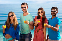 Friends relaxing in the seaside resort. Royalty Free Stock Image
