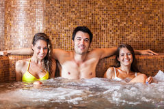 Friends relaxing in a spa Stock Images