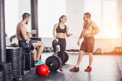 Friends relaxing and taking a break after working out at a cross-training gym. Friends relaxing and taking a break after working out royalty free stock photos