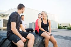 Friends Relaxing On Tire After Workout Stock Photos