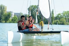 Friends renting a sailboat. Sailboat stock images