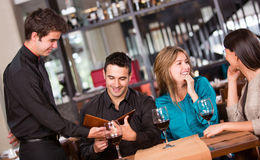 Friends at a restaurant Royalty Free Stock Photos