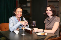 Friends at a restaurant drinking wine. royalty free stock photography
