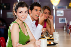 Friends in Restaurant eating and drinking Stock Photography