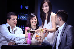 Friends in a restaurant Royalty Free Stock Photography