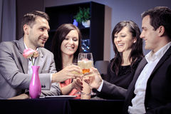 Friends in a restaurant Royalty Free Stock Image