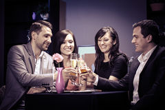 Friends in a restaurant Royalty Free Stock Images