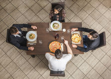 Friends at a Restaurant. Upper view of four friends at a table in a restaurant Royalty Free Stock Photo