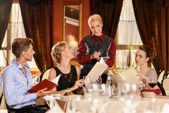 Friends in a restaurant Stock Images