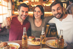 Friends resting in cafe Royalty Free Stock Photo