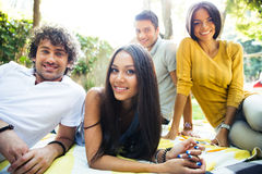 Friends resting outdoors in campus Royalty Free Stock Photography