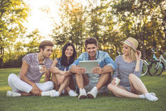 Friends resting in park Stock Image