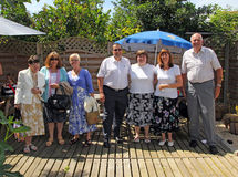 Friends reunion. Photo of group of friends reunion at a garden restaurant in whitstable kent on 22nd june 2014.photo ideal for friends,family groups,reunions etc Royalty Free Stock Photography