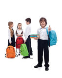 Friends reunite in school - back to school concept. Happy friends reunite in school after the long summer vacation  - isolated Royalty Free Stock Image