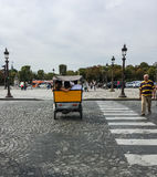 Friends ride in the back of a bicycle cab in the Place de la Concorde, Paris Stock Images