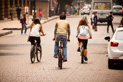 Friends riding a bicycle at downtown in Mexico City Stock Photo