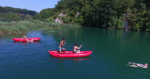 Friends riding canoe on river on beautiful sunny day on Mreznica river, Croatia stock video footage