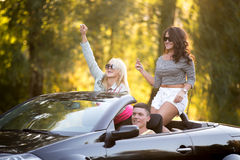 Friends riding convertible Royalty Free Stock Image