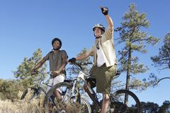 Friends Riding Cycle Together Stock Images