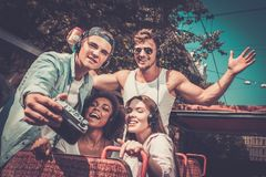 Friends riding on a sightseeing bus Royalty Free Stock Images
