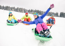 Friends riding sleds Stock Image