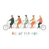 Friends riding a tandem bicycle together. Stock Photography