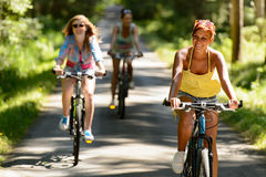 Friends riding their bikes in countryside Stock Photos