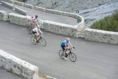 Friends with road cycles on uphill. Friends of biker by uphill with road cycling Stock Photos