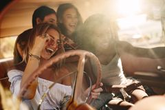 Young women enjoying on the road trip Stock Image