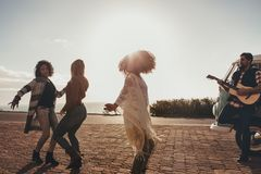 Friends on roadtrip dancing and having fun stock image