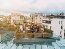 Friends on the Rooftop. Friends have fun on the roof of the house Stock Photos