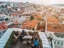 Friends on the Rooftop. Friends have fun on the roof of the house Royalty Free Stock Photography