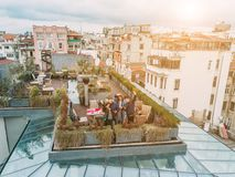 Friends on the Rooftop. Friends have fun on the roof of the house Royalty Free Stock Images