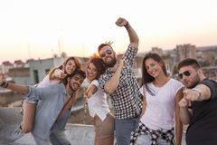Friends at a rooftop party stock photo