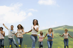 Friends Running Against Mountain Stock Image