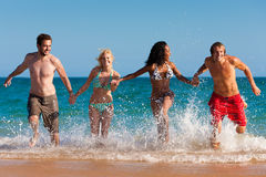 Friends running on beach vacation Royalty Free Stock Photo