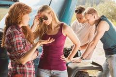 Friends running into car breakdown. Friends during trip running into car breakdown Stock Image