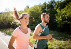 Friends running together Royalty Free Stock Photo