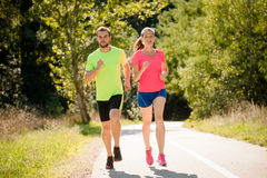 Friends running together Stock Photography