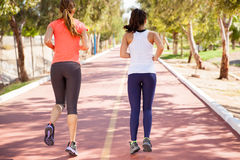 Friends running together Stock Images