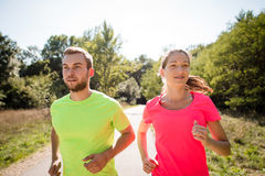 Friends running together Royalty Free Stock Images