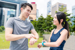 Friends running together and using smart watch in Hong Kong city Stock Photography