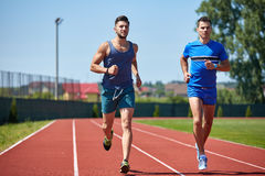 Friends running Royalty Free Stock Image