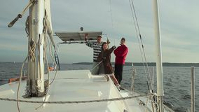 Friends on sailing yacht, company, active rest, vacation. Stock footage stock video footage