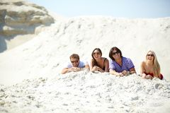Friends on sand Stock Photography
